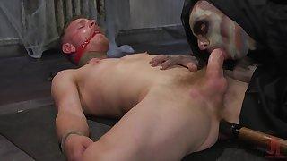 Costumed gay Cody Winter enjoys a blowjob by his kinky boyfriend