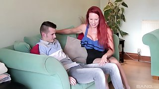 Mature redhead bombshell Julie Faye rides a younger dude in stockings