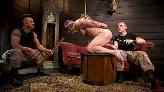 Submissive gay lad endures anal from his masters