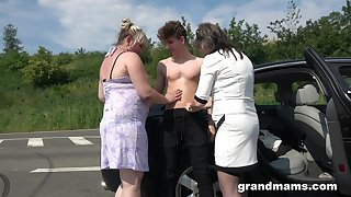 Two chubby grown up women bang young student on someone's skin road